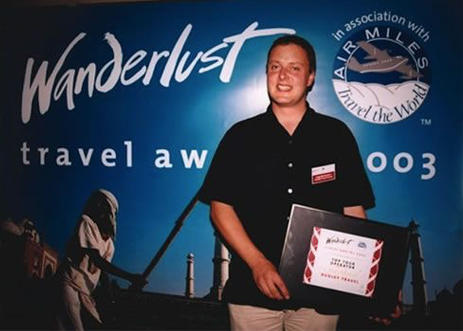 Craig accepting the 2003 Wanderlust award